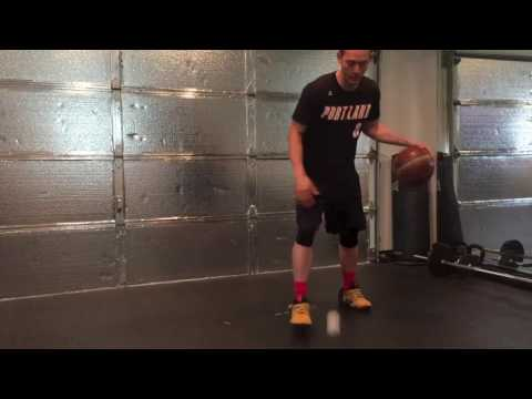 Cross-BTL dribble drill with lacrosse ball