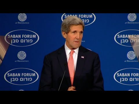 At - Secretary of State John Kerry delivers remarks at the Saban Forum in Washington, DC on December 7, 2013. A text transcript can be found at http://www.state.g...