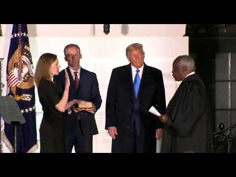 JusticeAmy Coney Barrett is sworn in by Justice Clarence Thomas to Supreme Court