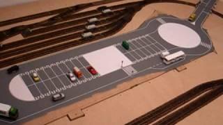 Vista general del circuit amb la seva zona d'aparcaments, semàfor, parada bus, pas a nivell, ... Vista general del circuito con su zona de aparcamientos, semáforo, parada bus, paso a nivel, ....