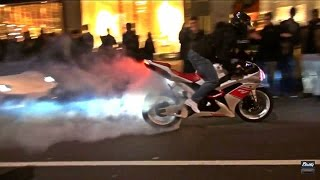 A Yamaha R1 equiped with an awesome Toce Exhaust System pulling off some wheelies and drifts ( and even a stopie!) in front of a crowd of people in central London!