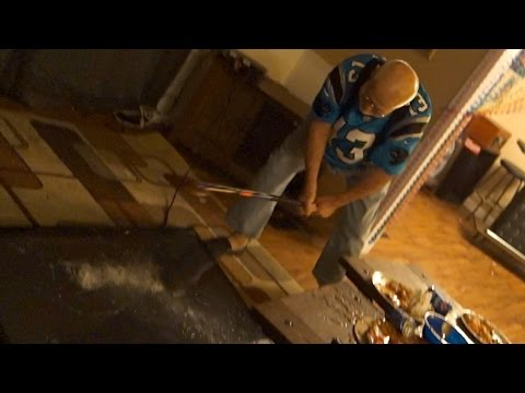 Angry Panthers fan destroys TV during the Super Bowl