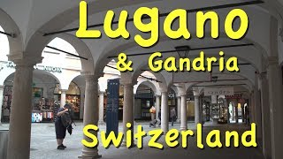 Please subscribe:  http://bit.ly/2pmdyeuSwitzerland playlist  http://bit.ly/2qsUismLugano, in the Ticino district of southern Switzerland on the shores of Lake Lugano, has both a medieval and Mediterranean feeling that you will discover in our in-depth visit, which also brings you to the lakefront villages of Gandria and Morcote.  We go by train, boat, on foot and funicolare to show you many great sites including Swiss Miniatur, with small models of Swiss buildings in a park setting, and the Alprose chocolate factory.The historic center of Lugano is famous for arcades that line both sides of the street forming covered sidewalk areas with a calm and sheltered environment, protecting you from the rain and sun.This style of columns and arches is reminiscent of Italian architecture -- after all, we are right next to Italy here in Lugano and you also see that feeling of Italy in the piazza, the big open square. The language is Italian and so is much of the lifestyle here in Ticino, which enjoys a magical blend of two cultures, with Swiss efficiency and Italian charm.You will love how well the pedestrian zone works – peaceful streets with people walking here and there. It is so friendly and sociable, makes for a great atmosphere.We really enjoyed stopping at this famous gourmet food shop, Gabbani, in business here since 1937 and they've really branched out – they've got a wine shop, a cheese shop, and they even run a small hotel that's ranked number three on Trip Advisor.This area is also world famous for its chocolates. In fact there's a chocolate factory just outside the city we visit, the Alprose, and you will see how they make their chocolates.Another feature that makes Lugano so attractive are the hillside streets. It's just so much more interesting than being in a flatland town. They've got staircase streets, they've got gently sloping streets, and it's all for pedestrians. It's a small part of town. It's a section which is goes up the hill alongside the funicular, 