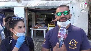 عنابة : جمعية ابتسم الخيرية توزع ألاف الكمامات على المواطنين