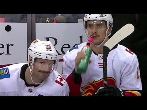 Video: Flames' Brouwer photobombs Backlund after goal to show off fine moustache