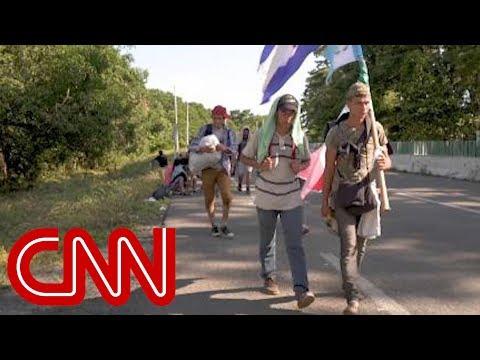 Migrants continue north, reject Trump's tweets