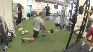 Exercise Index: Landmine reverse lunge with slide pad