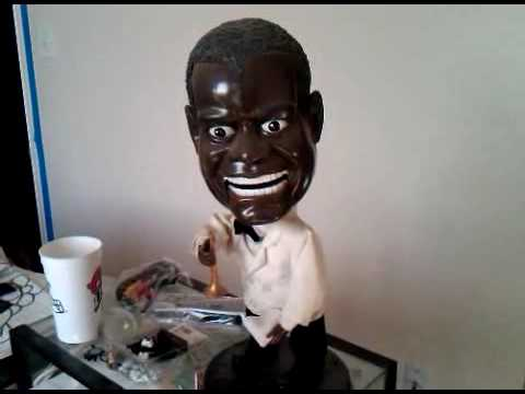 Horrifying Louis Armstrong Singing Doll running low on batteries