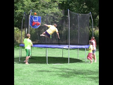 Skywalker Trampolines Jump N Dunk Trampoline with Safety Enclosure and Basketball Hoop Blue 15 Feet