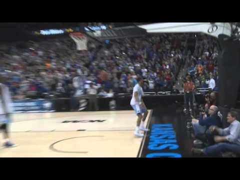 JP Tokoto Dunk Contest - North Carolina basketball player J.P. Tokoto jumps over teammate Joel James at the open practice in Kansas City before the NCAA Tournament.