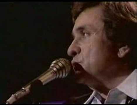Tekst piosenki Johnny Cash - Don't Take Your Guns To Town po polsku