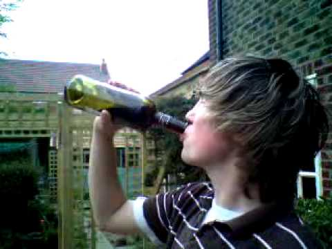Dan Davidson Downing A Bottle Of Wine