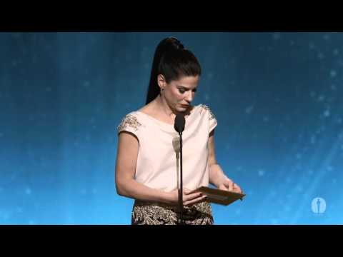 separation - Sandra Bullock presenting director Asghar Farhadi with the Oscar® for Best Foreign Language Film for Iran's
