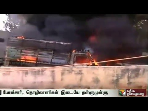 Violence-erupts-during-demonstration-by-workers-of-readymade-garment-factory-at-Bengaluru