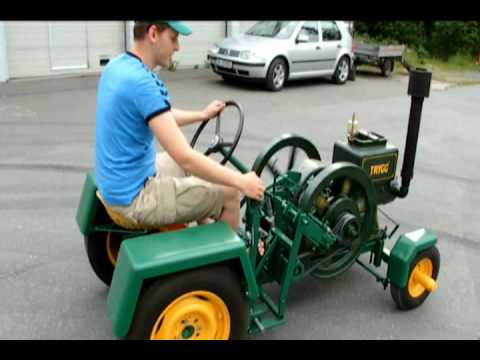 Home made tractor with  old hit and miss engine