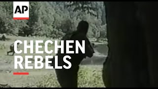 AMATEUR VIDEO - QUALITY AS INCOMING 1. Various of rebel group moving through forest 2. Various of rebel group conducting military training in forest ...