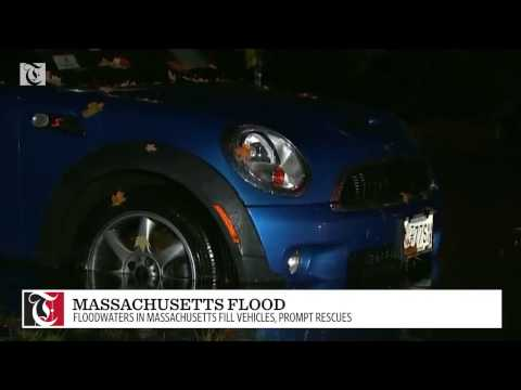 Floodwaters in Massachusetts fill vehicles, prompt rescues