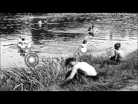 Video Displaced Russian people washing clothes and bathing in river Mulde in Grimma, Ge...HD Stock Footage download in MP3, 3GP, MP4, WEBM, AVI, FLV January 2017