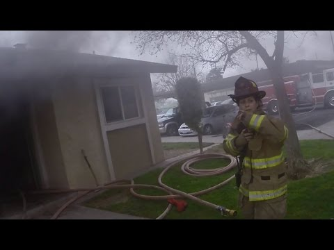 Helmet cam video of a firefighter rescuing 3 children from a burning home.