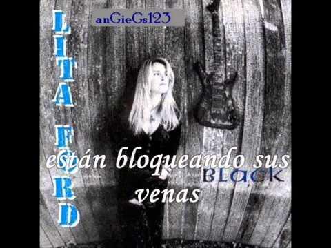Tekst piosenki Lita Ford - Hammerhead po polsku