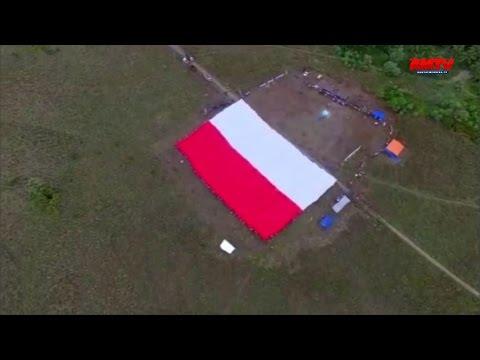 Rekor Upacara Di Bawah Bentangan Bendera Terbesar