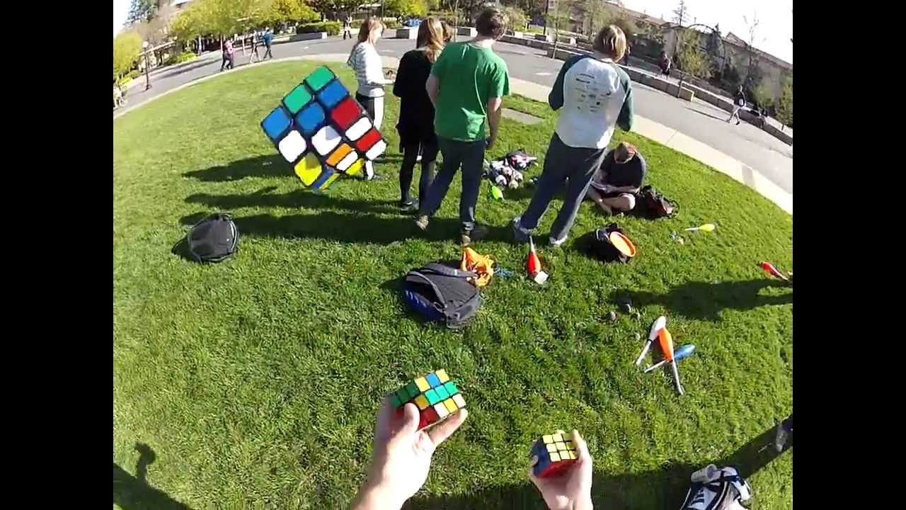 Solving three rubiks cubes while juggling them