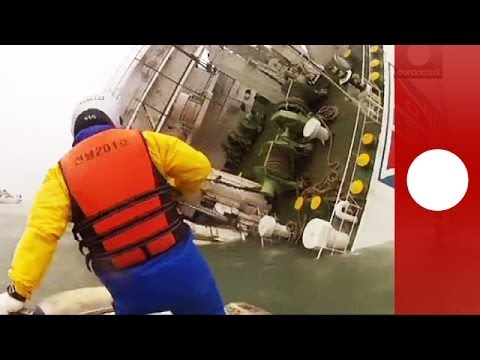 south - South Korean TV show footage of the sunken passenger ferry, as coaost guard patrols continue their efforts to rescue passengers from it. The passenger ferry,...