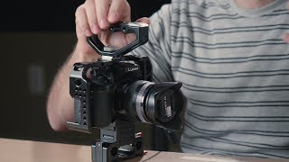 Even though exciting new cameras have come out in the last few years, I still use my GH4 a lot. In today's video, I talk about my favorite cage for this camera.More info: http://tomantosfilms.com/15848/my-cage-for-panasonic-gh4/You can get the CAME-TV camera cage for the Panasonic GH4 on:BH Photo Video https://goo.gl/X77xYSAdorama https://goo.gl/skUmKReBay https://goo.gl/gEZ5rnAmazon http://amzn.to/2sRiA0AAmazon Canada http://amzn.to/2ub0qedCAME-TV website https://goo.gl/TGRvD4If you want to get the whole rig, including the rails, follow focus and matte box, you can get it on:BH Photo Video https://goo.gl/WfXRZoAdorama https://goo.gl/A3JqP1eBay https://goo.gl/utjcZPAmazon http://amzn.to/2uaMUqTCAME-TV website https://goo.gl/1ai2SqMy favorite camera gear! https://goo.gl/fSWk1XCheck out Amazon for latest cameras http://amzn.to/2qOWytuExclusive tutorials: http://tomantosfilms.com/store/----------------------------------------------------------------------------------Remember, in filmmaking there's no problems, just a lack of solutions!Follow me on:Twitter: https://twitter.com/TomAntosFacebook https://www.facebook.com/TomAntosFilmsGoogle+ http://bit.ly/18oyRJBMy name is Tom Antos. I am a film director and cinematographer with over 20 years experience in VFX & animation.Jak się masz?! I'm originally from Poland ;)Check out my channel here: https://www.youtube.com/user/polcan99