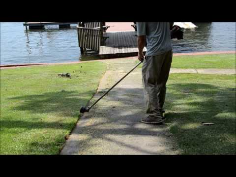 Edging an Overgrown Sidewalk with a Husqvarna String Trimmer (видео)