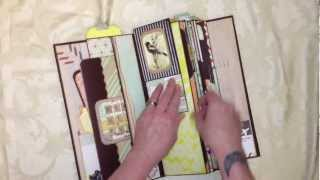 I finally finished it!!! This video will show you how I decorated it, and how I made some of the tags/pullouts for the different pockets and pages. I started...