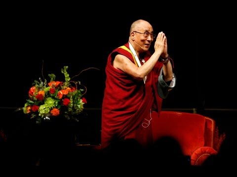 dalai - His Holiness the 14th Dalai Lama of Tibet takes the stage at the UO to ovation and cheers. (Chris PIetsch and Tiernan Pietsch/The Register-Guard)