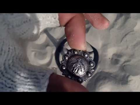 Metal detecting at beach with bounty hunter tracker IV May 1st two pendants found
