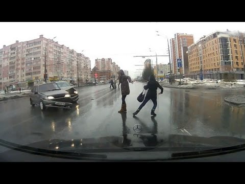 Pedestrians narrowly avoid being hit by crashing cars