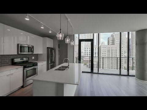 Tour a southeast corner 2-bedroom, 2-bath at River North's new Aurélien apartments