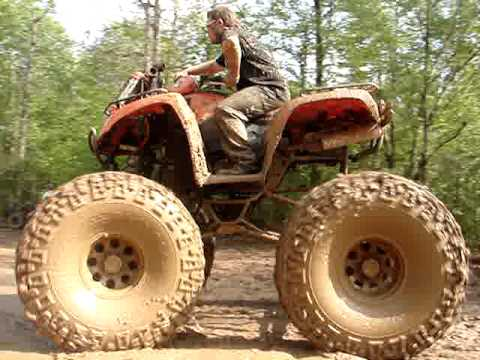 Lifted 4-wheeler rocks massive mud tires