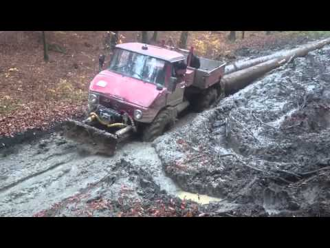 Mercedes Unimog pull heavy logs