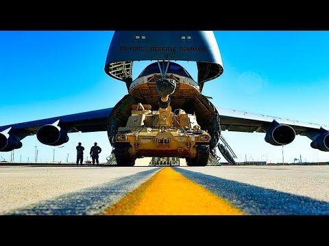 U.S. Air Force Airmen load C5M...