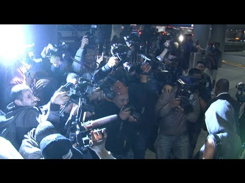 Rihanna gets mobbed by 40 paparazzi at LAX airport