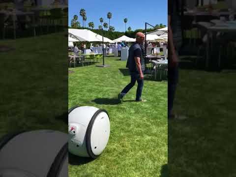 Amazon CEO Jeff Bezos has fun with Gita