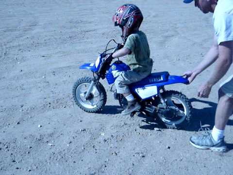 3 yrs old and riding dirt bike w/o training wheels (kinda)