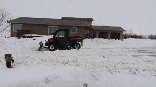 9. Can Am Defender HD 10 Working in the Snow