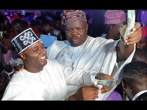 Download See how Femi Adebayo, MC Oluomo spray bundle of cash on Abimbola and Okiki at Their Wedding