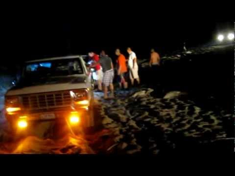 Playa Boca Chica Beach - pulling a stuck truck out of sand.