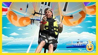 LB is going parasailing for the first time, and Aaron is on the lookout for sharks in the water below! In this fun family video, Aaron ...
