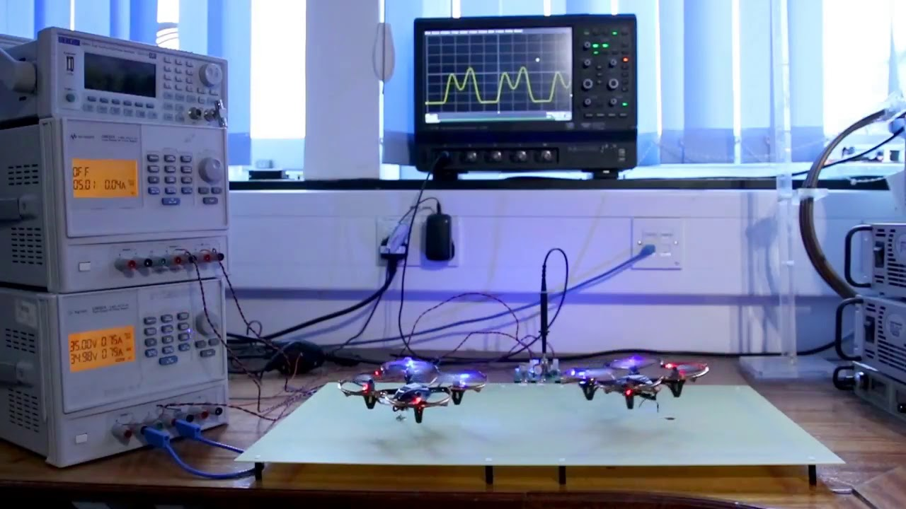 Indefinite powering of 2 battery-less drones within the same energized zone generated by a single charging coil