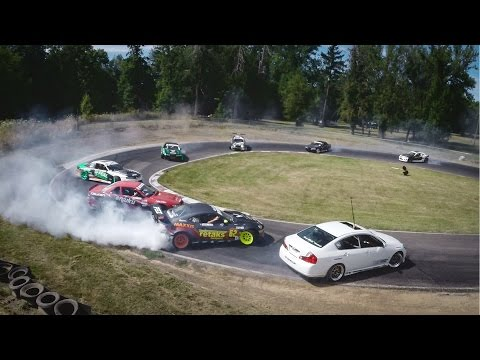12 cars drifting on a racetrack