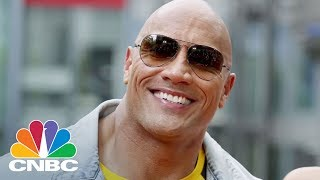 "Dwayne ""The Rock"" Johnson teamed up with Apple for a new commercial promoting Siri.» Subscribe to CNBC: http://cnb.cx/SubscribeCNBCAbout CNBC: From 'Wall Street' to 'Main Street' to award winning original documentaries and Reality TV series, CNBC has you covered. Experience special sneak peeks of your favorite shows, exclusive video and more.Connect with CNBC News OnlineGet the latest news: http://www.cnbc.com/Find CNBC News on Facebook: http://cnb.cx/LikeCNBCFollow CNBC News on Twitter: http://cnb.cx/FollowCNBCFollow CNBC News on Google+: http://cnb.cx/PlusCNBCFollow CNBC News on Instagram: http://cnb.cx/InstagramCNBCDwayne 'The Rock' Johnson Teamed Up With Apple For A New Commercial Promoting Siri  CNBC"
