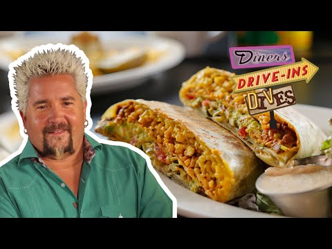Guy Fieri Tries an INSANE Vegan CRUNCHWRAP (from #DDD) | Food Network