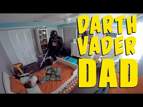 Guy awakes his son as Darth Vader
