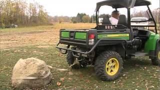 3. John Deere Gator 825I pulling pet rock